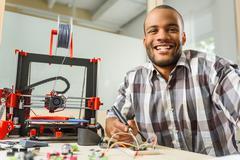 Joyful young man engineering 3d printing Kuvituskuvat