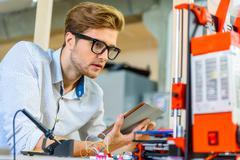 Skillful male engineer using 3d printing Kuvituskuvat