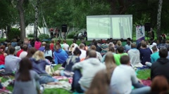 Russia, Novosibirsk, 2016: Showing an open-air movie. The screen Stock Footage