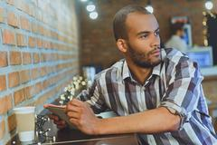 Cheerful guy entertaining in cafe Stock Photos