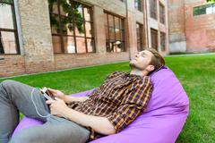 Relaxed guy resting with melody Stock Photos