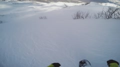Snowboarder backcountry ride from top of snowy mountain. High speed. Extreme Stock Footage