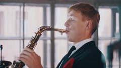 Saxophonist in dinner jacket performing on stage of restaurant. Jazz music Stock Footage