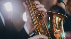 Saxophonist in dinner jacket perform on stage. Spotlight. Golden saxophone. Jazz Stock Footage