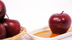 Pile of red apples and red apple on white plate with honey Stock Footage