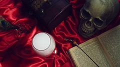4k Abstract Halloween Background Composition with Skull, reading the book Stock Footage