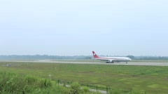 Airplane is taxiing on the runway after landing on Chengdu Shuangliu airport Stock Footage