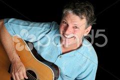 Grinning Guitarist Stock Photos