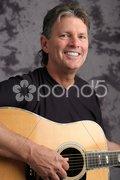 Stock Photo of Mature Male Guitarist 4 Stock Photos
