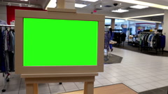 Green billboard for your ad inside The Bay store Stock Footage