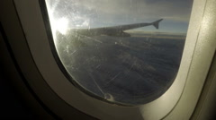 Hand closing airplane window shade - blinding wing view from passenger seat Stock Footage