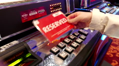 Motion of people putting reserved card on slot machine Stock Footage