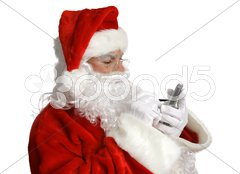 Santa Checks List on PDA Stock Photos
