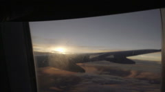 Closing window shade on airplane at sunset in flight Stock Footage