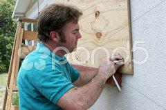 Attaching Plywood to Windows Stock Photos