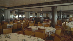 Elegant, stylish restaurant interior - laid tables in the cruise ship Stock Footage