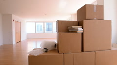 Bubble wrap and cardboard boxes in empty apartment Stock Footage