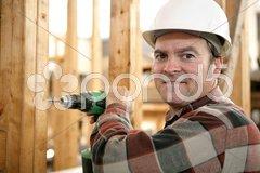 Carpenter Drilling Wood Stock Photos