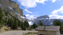 Fast driving a car through the winding road in the dolomites, Italy Stock Footage