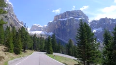 Speeding car on a winding road in the Dolomites, Italy Stock Footage
