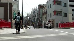 Tokyo - Street view with people and traffic on the bridge. 4K resolution Stock Footage