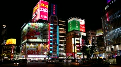 Tokyo - Night street view with glowing signboards and traffic at Shinjuku. Stock Footage