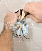 Electrician Attaching Ceiling Box Stock Photos