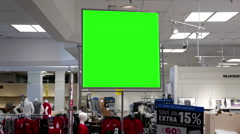 Green billboard for your ad inside The Bay store in  Lougheed Town Centre mall Stock Footage