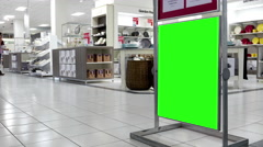 Green billboard for your ad inside The Bay store in Burnaby shopping mall Stock Footage