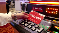 Motion of people putting reserved card on slot machine inside Hard Rock Casino Stock Footage