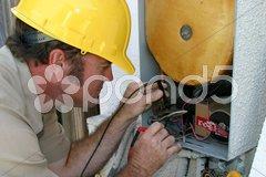 Air Conditioning Repairman Working Stock Photos