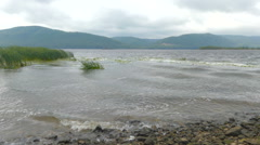 Waves on the shore of the river Volga, Russia. A storm in autumn day. The mou Stock Footage