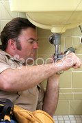 Plumber Using Pipe Wrench Stock Photos