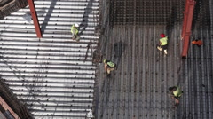 Roofer construction workers works in a construction site Stock Footage