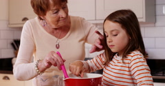 4k, Grand mother and  daughter in the kitchen preparing to bake a cake. Stock Footage