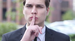 Gesture of Silence by Young Businessman Stock Footage