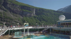 Cruise ship cruising in fjord - onboard view Stock Footage