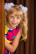 The girl hid behind the wardrobe Stock Photos