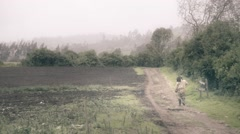 Farmer on dirt road. Stock Footage