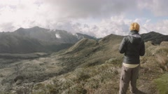 Explorer on top of mountain Stock Footage
