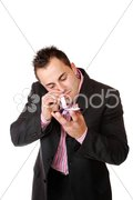 Young man sniffing cocaine. Stock Photos