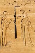 Carving of Egyptian god on pylon (Island  Philae, Egypt) Stock Photos