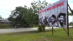 Communist propaganda billboards line a road in Cuba includes Fidel Castro and Stock Footage