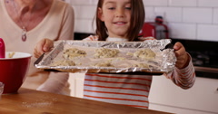 4k, Little girl proudly shows off a tray of  cupcake mixture ready to bake. Stock Footage