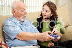 Teen Helps Grandpa Stock Photos