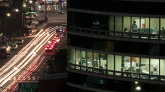 Timelapse of office life and city traffic at night. Seoul, South Korea Stock Footage