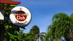 A sign for Havana Club rum identified a bar or restaurant in Cuba. Stock Footage