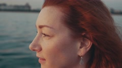 Red hair young girl drive motor boat. Summer evening. Entertainment. Sailing Stock Footage