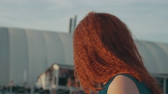 Red hair girl in motor boat. Enjoy summer evening. Entertainment. Sun beams Stock Footage