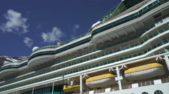 Cruise ship side view - rescue boats and cabins Stock Footage